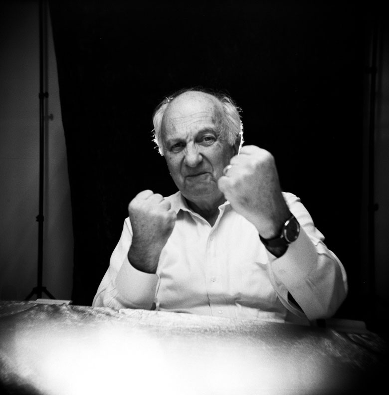 Portrait of man striking a boxing pose.