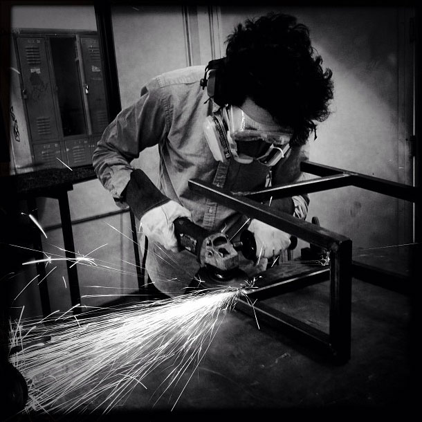 Student working on a steel stool frame.